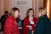 Michele Hartlove and Sarah Mashburn, both of the Prevention of Blindness Society, chat with a Book of List attendee.