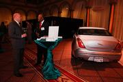 Jerome Cabbagestalk of Tysons Corner Jaguar, right, talks with a guest about the vehicle.