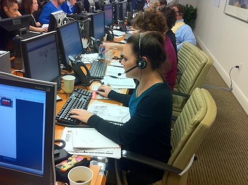 "Jennifer Pike, an associate in the District office of Reed Smith LLP, answers calls from voters at an ""election protection"" phone bank."