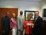 As part of UPS' commitment to the Greater Washington Urban League,  UPS representatives presented GWUL President and CEO Maudine Cooper with a $21,000 check. From left, Dominic Jordon of UPS, Queen Gladden of GWUL, Anthony Heath of UPS, Cooper and Bill Wegemann of UPS, also a GWUL board member.