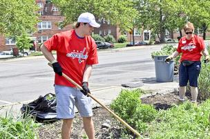 Washington Capitals fans who weeded tree boxes outside the Fort Dupont Ice Arena in June got some help from defenseman John Carlson.