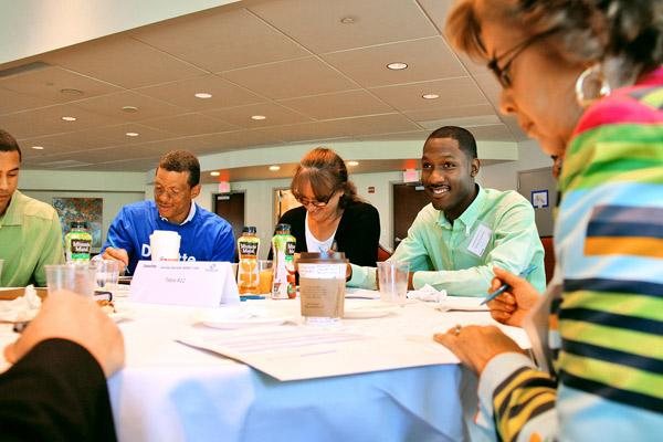 Deloitte staffers lead team-building talk for Boys and Girls Clubs.