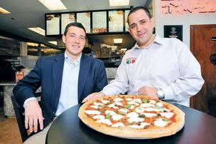 Mike Halpern and Fouad Qreitem are taking Paisano's pizza directly to the kids at GMU through a new contract.