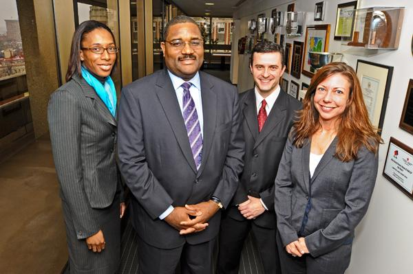 Akin Gump partner Tony Pierce, second from left, is with past summer associates, from left, Angela Adams, Nathan Oleson and Debra Drake.