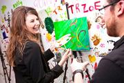 """A brush with art """"Paint and sip"""" studio ArtJamz re-opened its expanded Dupont Circle space March 14 with a VIP preview party. Amber Sutton of Dogtopia traded leashes for brushes for the night as she took the new studio for a spin."""