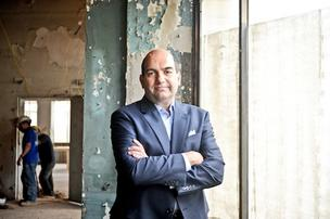 Retail broker John Asadoorian, pictured at the future home of celebrity chef Stephen Starr's French bistro at 14th and Q streets NW, worries that the 14th Street area's cap on restaurants per block will become an escalating issue.