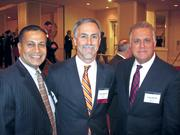 A warm welcome on a cold, cold day The Greater Washington Board of Trade gathered its members Jan. 7 for its 125th annual meeting, held at the Capital Hilton. Incoming Board of Trade Chairman Stu Solomon of Accenture, center, with Gautam Chandra of Washington Gas, left, and Jorge Benitez, also of Accenture.