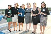 """Children's Law Center Children's Law Center drew a crowd of 400 guests to the Kennedy Center's Rooftop Terrace for its annual """"Helping Children Soar"""" benefit, including, from left, Ellie Mix, Cameron Moss, Joyce Ramirez, Mary Margaret McLeroy, Katie Brewer and Lily Roberts, all of The Advisory Board Co."""