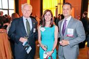 From left, Richard Horan and Carine Stoick of Hogan Lovells with benefit co-chair Evan Farber of The Advisory Board Co.