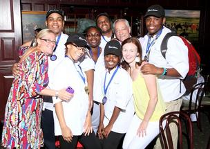 "Bistro battleCohn's Kitchen conducted the Second Annual Battle of the Bistros on July 30 at Clyde's Gallery Place. The event, held in conjunction with D.C.'s Department of Employment Services and the Summer Youth Employment Program, is the culmination of a restaurant job-training program. Student teams use their training to vie for the bragging rights of ""Best New Restaurant Concept."" This year's winning team, Pangea, comprised, from left, teacher Amy London, students Rashad Kemp, Doneisha Martin, Tae Hall, Michael Kemp and Donieha Jackson, co-founder Paul Cohn, co-founder and Executive Director Elizabeth Scott, and student Kevin Kemp."