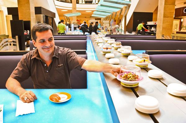 After seeing the success of his conveyor belt sushi at Tysons Corner Center and a Boston mall, Wasabi Restaurant founder Bo Davis has decided to sell two other food ventures and concentrate on mall possibilities.