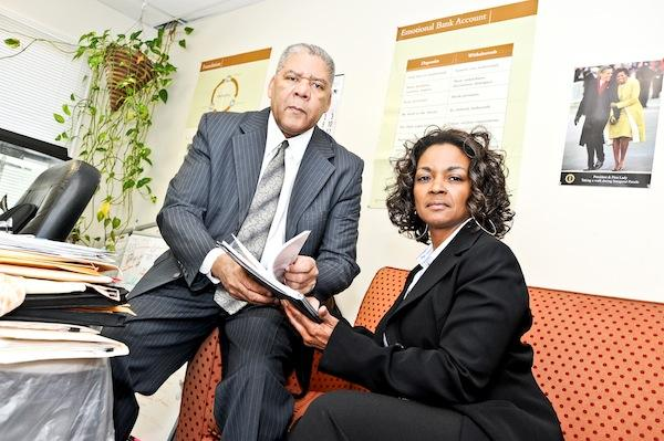 EDTI chief Joe Gaskins, with business owner Lisa Ellis, says his organization would be forced to close if it cannot close a deal with a new lender.
