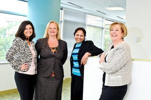 From left, Lisa Martin of LeapFrog Solutions Inc., Kristina Bouweiri of Reston Limousine Service Inc., Jay Jayaram of Comter Systems Inc. and Janet Amirault of Software Consortium Inc.