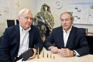 Ken Hintz, left, a George Mason University professor, has secured several radar technology patents. Jim Wolfe was tapped to build a company around that work. The result is FirstGuard Technologies, which is developing technology to detect snipers and explosives.