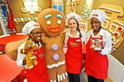 """Shrek"" star Gingy poses with fellow Gaylord workers at his Gingerbread House, one of many activities that make up the hotel's ICE program."