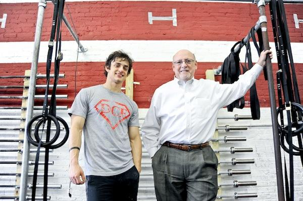 When gym owner Andrew Killion, left, realized he needed to get his business skills in shape, he got some help from Georgetown MBA students participating in a small business clinic run by professor Jim Hunt.