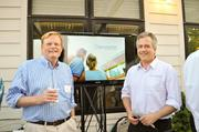Ups for the rooftopGeostellar hosted a D.C. launch party Sept. 6 at Landis Construction's offices in the District. Landis recently completed a 30-kilowatt solar installation on their roof, installed and designed by Kenergy, a solar installer. Above are Chris Landis of Landis Construction, left, and David Levine of Geostellar.