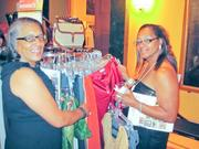 Just in case they couldn't get enough fashion on the runway, guests, including Mariah Barnes, left, and Trisha Washington, both of the HSL Foundation, could also sneak in some shopping at the evening's Goodwill Pop-up Shop.