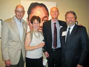 Many Meloys abound around Goodwill, including, from left, David Meloy of the Merit Hotel Group, Rosa Proctor of Goodwill of Greater Washington, David Meloy, also of Goodwill, and Glen Howard of the Pew Charitable Trusts, and Goodwill board member.