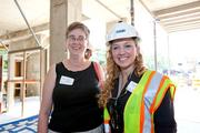 Done and doneHitt Contracting, Arlington County and architect DCS celebrated the revitalization of Columbia Pike Sept. 7 at the topping out of the Arlington Mill Community Center, an integral piece of the project. Above are Arlington County Board Chair Mary Hynes, left, and Amanda Logsdon of Hitt Contracting.