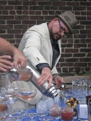 """Mixologist Dan Searing of Room 11 pours his """"Smoke Gets in Your Eyes"""" cocktail."""