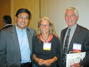 From left, forum creator Tien Wong of Lore Systems, investor Anne VanGilson and John Holaday of Pixspan.