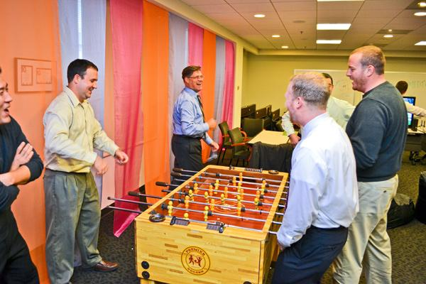 ImmixGroup employees take a brief foosball break during their busiest time of year. Playing hard are, clockwise from left bottom corner, John Kim, Nate Rochel, Art Richer, Nabeel Ahmadieh, Ben Ball and Patrick Toland.