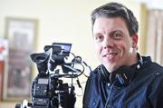 Instead of retrenching during the recession, Keith Jodoin expanded  his video production company. The expanded business turned out to be a  hit with clients, says Jodoin, shown on location for a film.