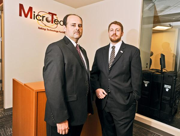 """Bill Lytle, left, and Aaron Drabkin of MicroTech have seen what happens when lucrative work is moved to large umbrella contracts they can't access.  That can leave a small business """"jockeying for a position on someone else's team,"""" Lytle says."""