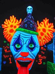 Monster Mini Golf's clownish 18th hole is named Glo-Zo. There are plans for 11 of the courses in the Washington region.