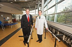 National Rehabilitation Hospital President John Rockwood, left, with Chief Medical Officer Michael Yochelson, says the average stay at the hospital is 17 days, down from more than two months when the hospital opened in 1986.