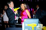 "WUSA9 anchor Lesli Foster in said same dress, with one of the ""Newsmen in Pink,"" Steve Chenevey of ABC 7, as they shop the silent auction."
