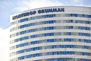 Northrop Grumman Corp. reported lower net earnings in the second quarter, but raised its earnings guidance thanks to a growing backlog of new business, the defense contractor said Wednesday.