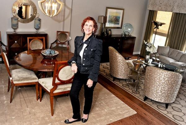 To keep customers during the recession, interior design firm owner Anita Perlut offered new products that sparked her clients' interest.
