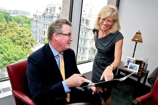 """Warren Bischoff, senior managing director of RBC's D.C. office, here with Senior Vice President Amy Sturtevant, wants his employees to feel like their co-workers are their """"surrogate family."""""""