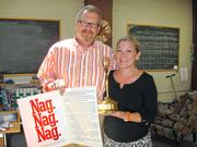 Matt Smith, CEO of SmithGifford, and wife Suzy show off an award-winning resume that Matt had designed for Suzy when she was starting off in the ad business.
