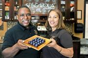 Eric and Crisoire Reid turn cocoa beans from their farm in the Dominican  Republic into chocolate truffles at their factory in Gaithersburg.