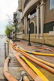 MRP Realty hired 100 workers to pump out flood water from Georgetown's Washington Harbour.