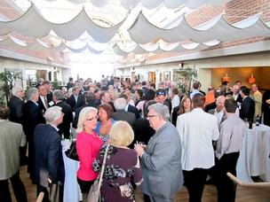 Several hundred Andersen alumni attended this year's local reunion at the Tower Club, where Andersen had a large local office.