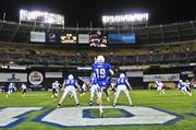 Air Force Falcons punter David Baska boots the football from his own end zone during last year's Military Bowl matchup against the Toledo Rockets. Toledo defeated Air Force 42-41.