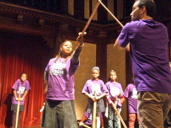 Folger Shakespeare Library officials say they may be forced to cut on-site education programs, such as the one above, where local students were taught sword-fighting techniques to use on stage.