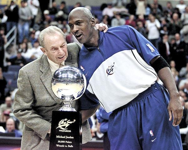 Wizards' owner Abe Pollin congratulates Michael Jordan for notching his 30,000th career point in January 2002. Pollin built MCI Center and moved the Wizards and Capitals to downtown D.C. Jordan helped fill seats after he returned from retirement.