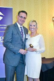 C. Michael Ferraro of Training Solutions Inc. and Chamber Chairman Jane Raymond of Reston Hospital Center.