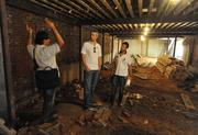The design and construction team inspect the basement space of Bart Vandaele's new restaurant.