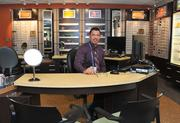 """Optician Luis Rodriguez at """"Vision Essentials,"""" the onsite optical department at Kaiser Permanente's Tysons location."""