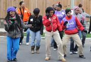 Volunteers take a dance break that created a community block party feel while building the new playground on the grounds of DASH's Cornerstone Housing Facility on Saturday, Nov. 3.