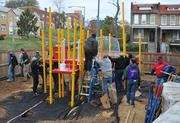The playground took shape throughout the day on the grounds of DASH's Cornerstone Housing Facility on Saturday, Nov. 3.