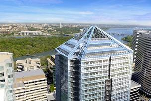 Monday Properties' 1812 N. Moore in Rosslyn, well under construction, will boost Arlington's commercial office space total by nearly 600,000 square feet. But Arlington's 2Q building report suggests a construction slowdown.