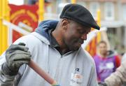 Washington Redskin alum Ken Harvey volunteered mixing concrete for the playground build on the grounds of DASH's Cornerstone Housing Facility on Saturday, Nov. 3.