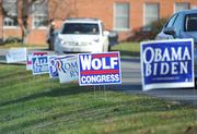Signs litter the road leading up to the Waterford voting precinct on the morning of Election Day.